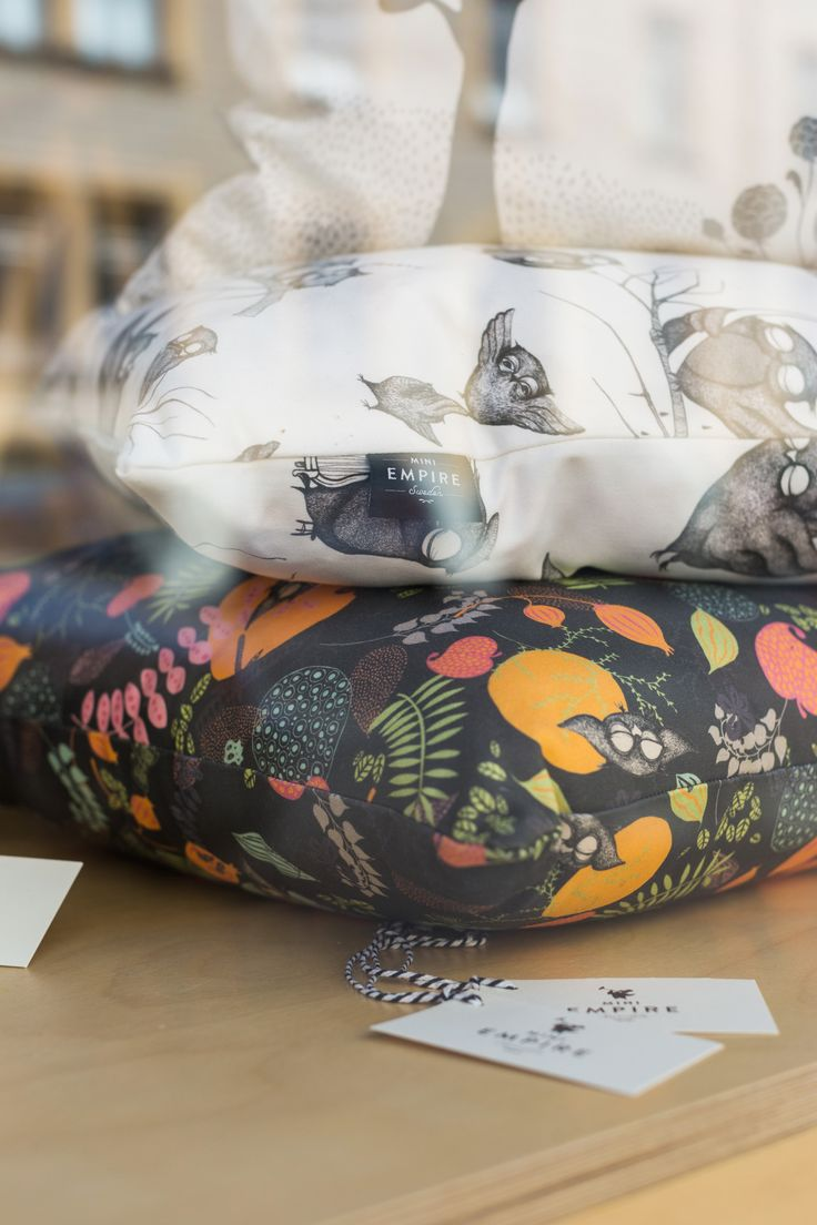 Close-up on our cushions Forest Night and Owls through the studio window at Mini Empire