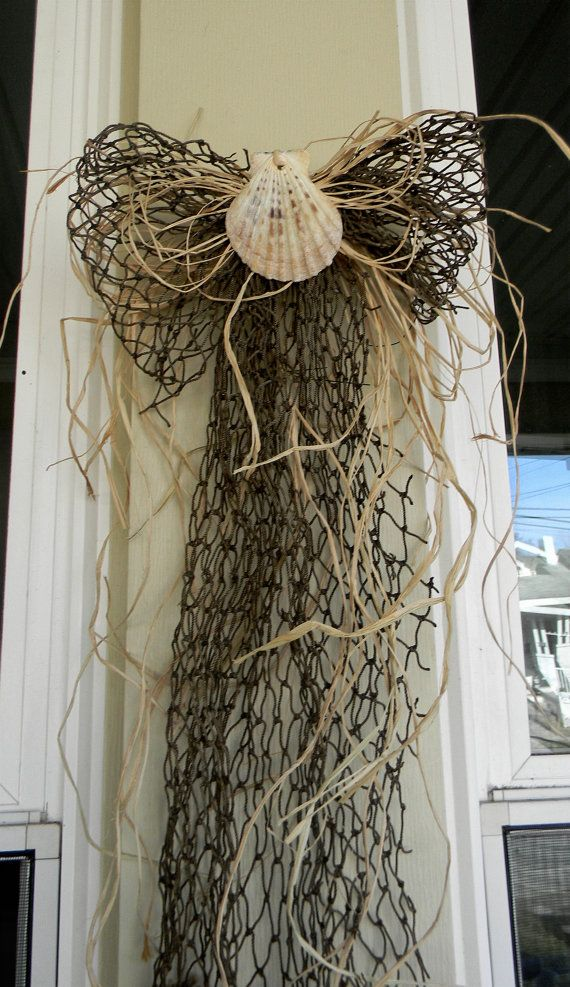 Hey, I found this really awesome Etsy listing at http://www.etsy.com/listing/114403828/nautical-fish-net-bow-sea-shell-bow