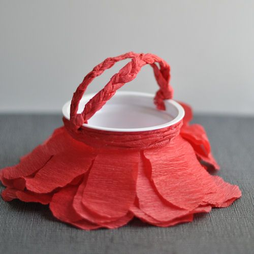DIY Simple Red Petal May Basket by designmom: Made with a cleaned out yogurt cup and crepe paper! #DIY #Kids #May_Basket
