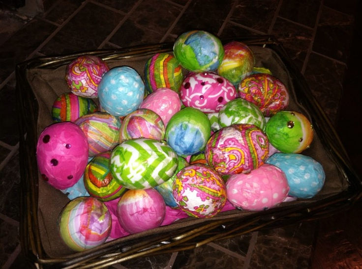 Cheap plastic white eggs 60 cents/pckg of 12. Decoupaged with ModPodge and napkins/tissue paper.