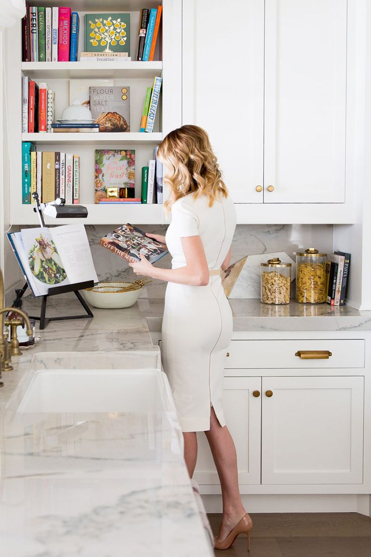 white kitchen countertop bookshelf for cookbooks