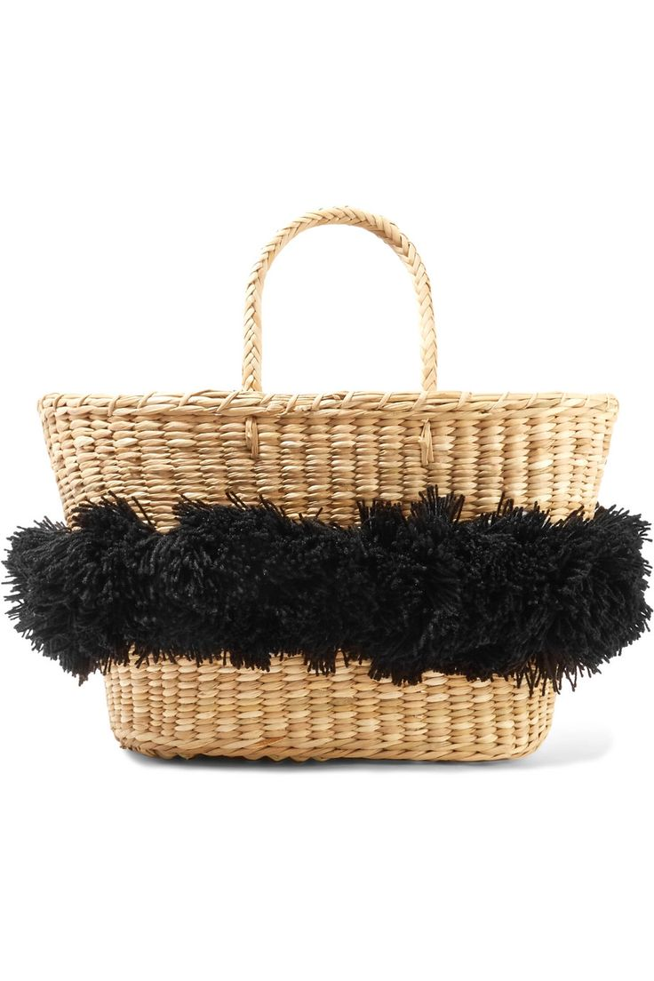 Nannacay's 'Mikonos' tote should be first thing you buy for your next getaway. Woven from durable raffia, this handmade style is decorated with black fringed pompoms. The interior is spacious enough for beach essentials like a magazine and extra sunscreen. Carry it by the braided top handles.