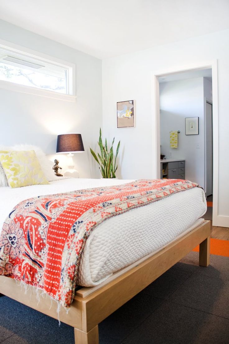 neutral room with a colorful throw