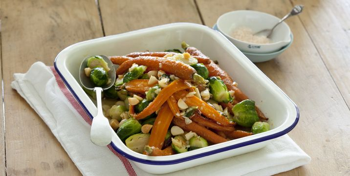 Warm salad of honeyed baby carrots, brussels sprouts and macadamias