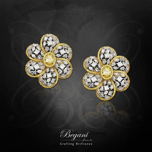 Natural yellow oval diamond set with mixed-shaped diamonds #beganijewels
