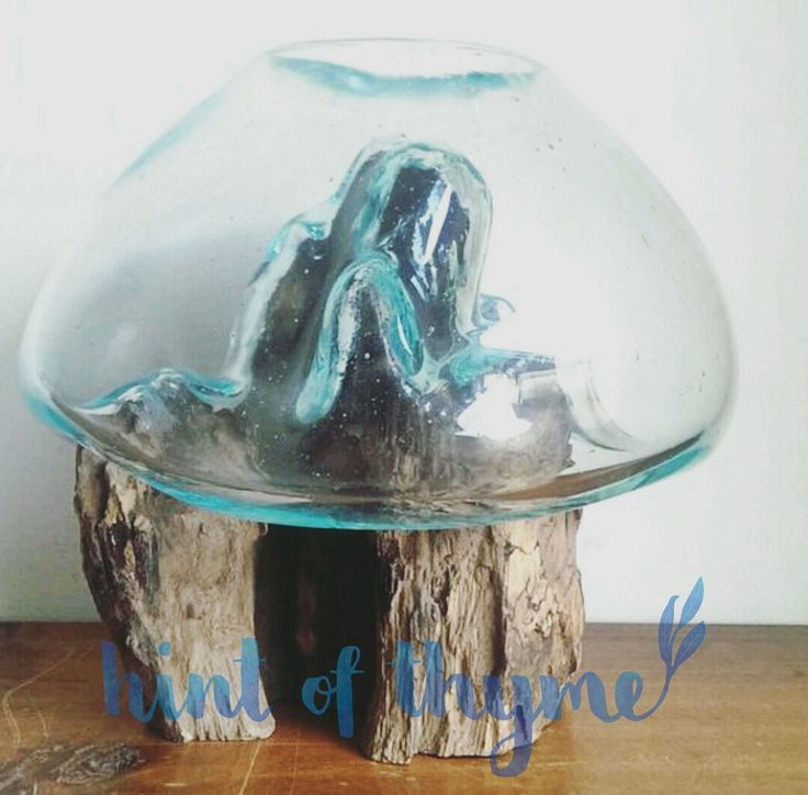 Handmade blown glass bowl on a natural teak wooden base, B size.Each item is unique as they are made from natural wood.