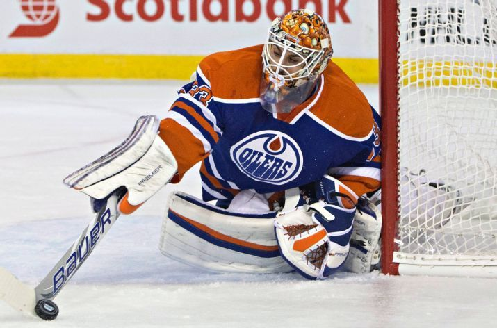 Edmonton Oilers goalie Cam Talbot (33) makes a save against the Detroit Red Wings during the first period of an NHL hockey game in Edmonton, Alberta, Wednesday, Oct. 21, 2015. (Jason Franson/The Canadian Press via AP)