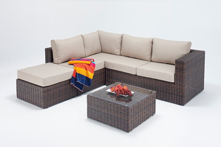 Brown round poly-rattan with cream cushions - Left Hand Facing