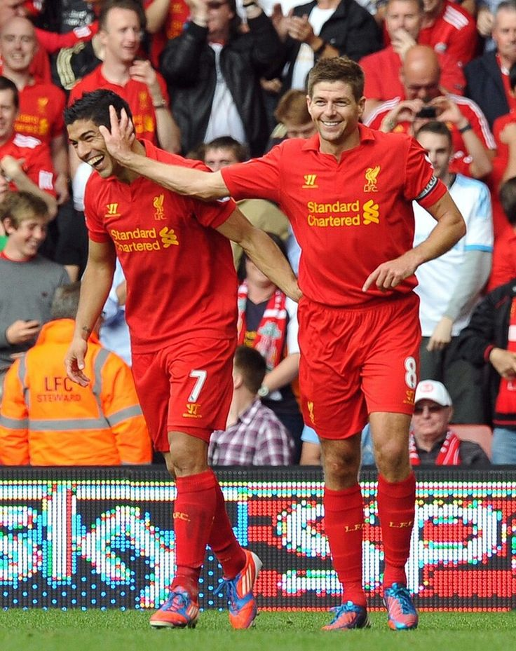 Luis Suarez and Steven Gerrard. Great team players who are able to define team work and leadership encouragement in 90 minutes!