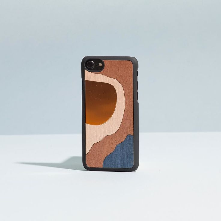 Playing with materials  We are in love with these redesign of our classic Bronze Case. Get and customize yours on woodd.it  #woodd #bronze #wood #design