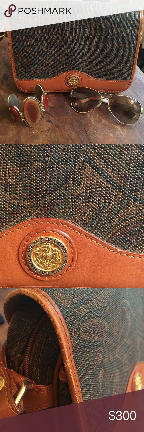 RARE vintage Pierre Balmain purse! A vintage Balmain crossbody bag in excellent condition. There is slight wear to some of the brown leather on the outside of the bag, but could easily be touched up by a cobbler or handbag repair person. Balmain Bags Crossbody Bags