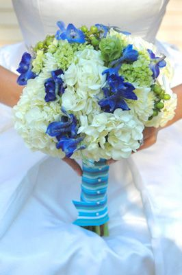 white hydrangea and blue delphinium bouquet. I would use a pale pink flower instead of green