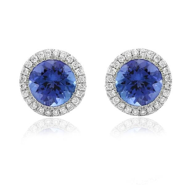 Rare and beautiful. Kilimanjaro stud earrings featuring a stunning matched pair of round faceted tanzanites surrounded by a halo of diamonds. Gerard McCabe's Kilimanjaro collection is a celebration of this wildly passionate gemstone. Tanzanite is truly one of nature's most exquisite creations. These earrings are crafted in 18ct white gold for pierced ears.
