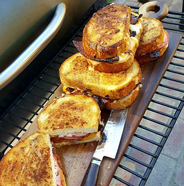 Last nights Traeger grilled cheese like no other . Fresh sliced sour dough bread, aged sharp cheddar, gouda, cream cheese, Traeger bacon, tomato and Mayo with parmesan cheese on outside of bread for crisp.