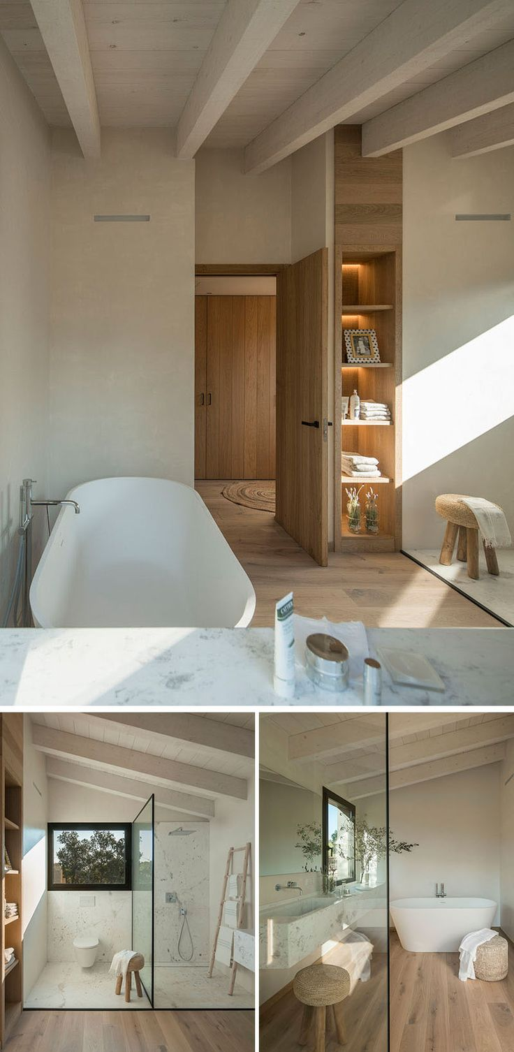 In this modern bathroom, built-in wood shelving with back-lighting provides a place to store bathroom items, while a freestanding bathtub sits against the wall. Opposite the bathtub is the toilet and shower that are separated by a glass shower screen, and next to the bathtub is a floating vanity. #ModernBathroom #BathroomDesign #WoodShelving