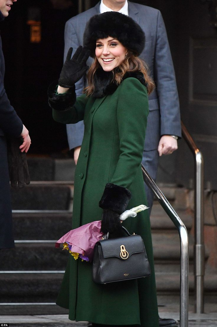 Pregnant Kate's baby bump was barely visible beneath the stylish green coat by favourite royal designer Catherine Walker
