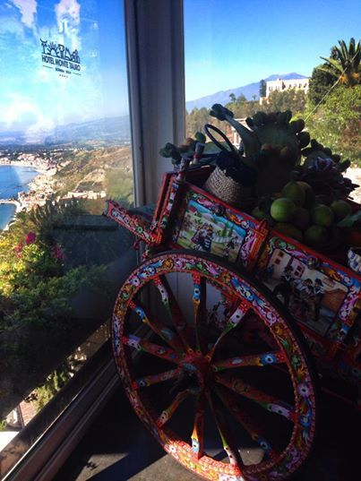 I love this pic made with my iphone almost for a joke .. no filters!  it is so rich of Sicilianity ..  the Great Mount Etna and the Sea on the back for sure make the difference.. This is #Taormina and a view from our breakfast room....