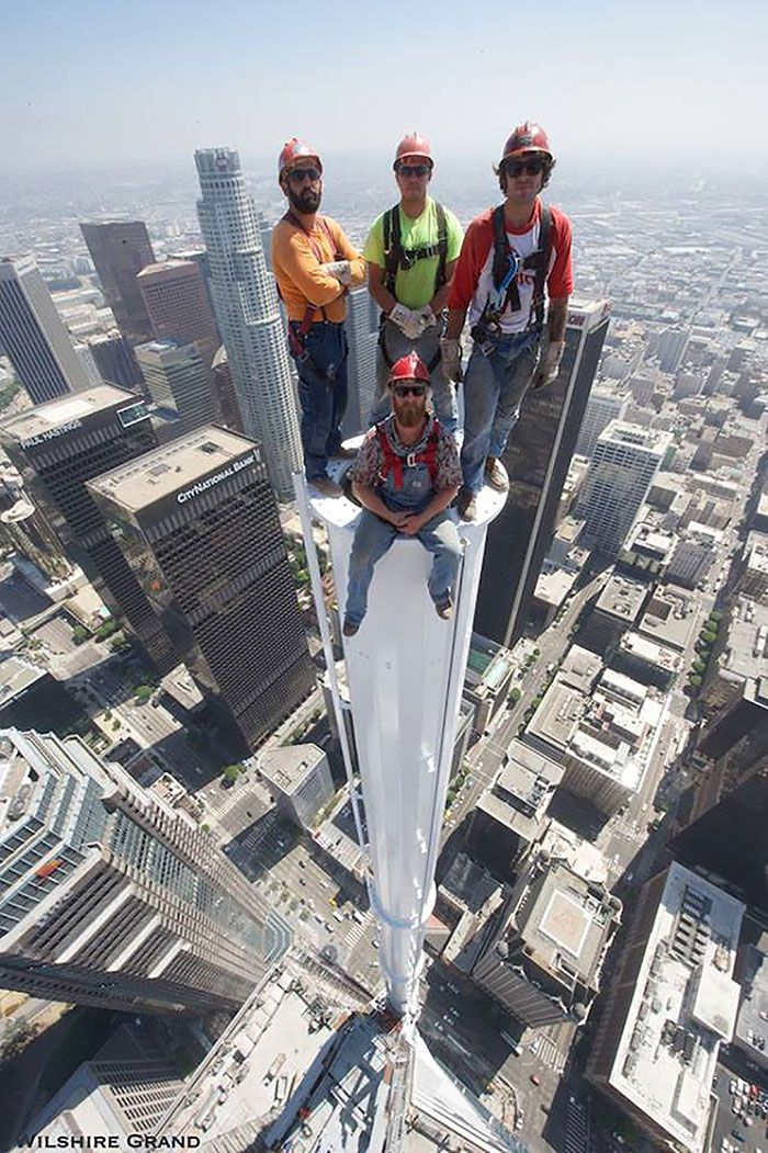 Workers pose for picture atop the Wilshire Grand Tower in downtown LA