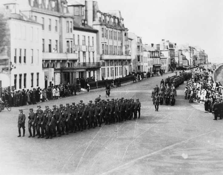 Guernsey, Channel Islands, 1940: German troops marching along North Esplanade, St Peter Port. Invaded in June 1940, the Channel Islands were the only British territory to be occupied by the Germans during World War Two. The islands were seen as a stepping stone to the invasion of Britain proper.