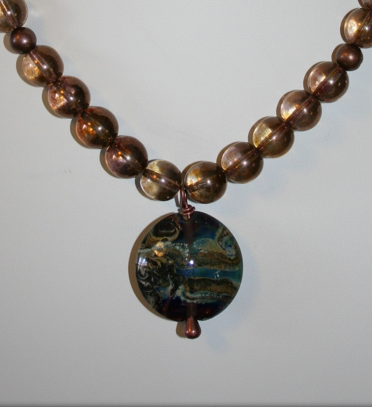 Golden Sky - Wonkets Necklace (lampworking) - This lovely piece is made from golden druks, with an antique gold-toned shepherd's hook clasp. The focal Wonket features a swirling pattern evoking a stormy evening sky.