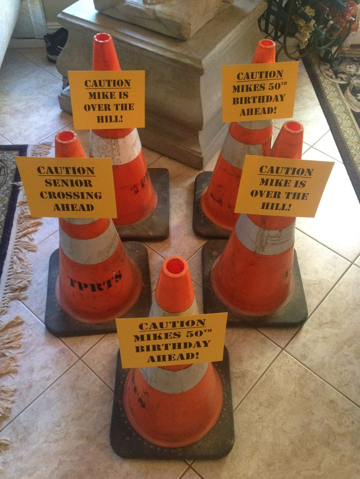 "I was able to borrow these construction cones from my dad for an ""Over the Hill"" 50th birthday party that I did for a client. Each paper had a different sign. They lined the steps going up to the house. It was a perfect entrance to poke fun at the Birthday Boy! http://eventsbyashleymaegan.com/"