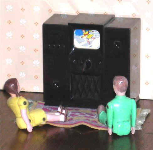 At 3½ inches high, the Ideal Young Decorator television and radio of  the early 1950s with rotating colour pictures is in a larger scale (although TVs of the '50s in cabinets were large) than the usual plastic items. (I have a boy and, I think, the case of the TV.)