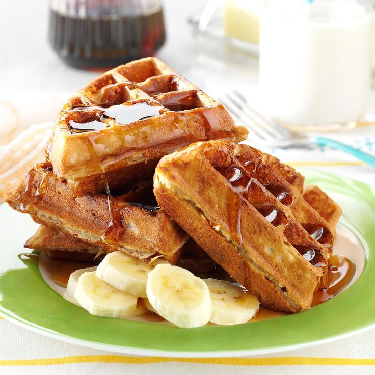 Peanut Butter and Banana Waffles Recipe -I love bananas and I love to make breakfast, too. These are a refreshing change from your everyday waffles. I like to make big batches up so I can freeze the leftovers and reheat them later for a quick breakfast.