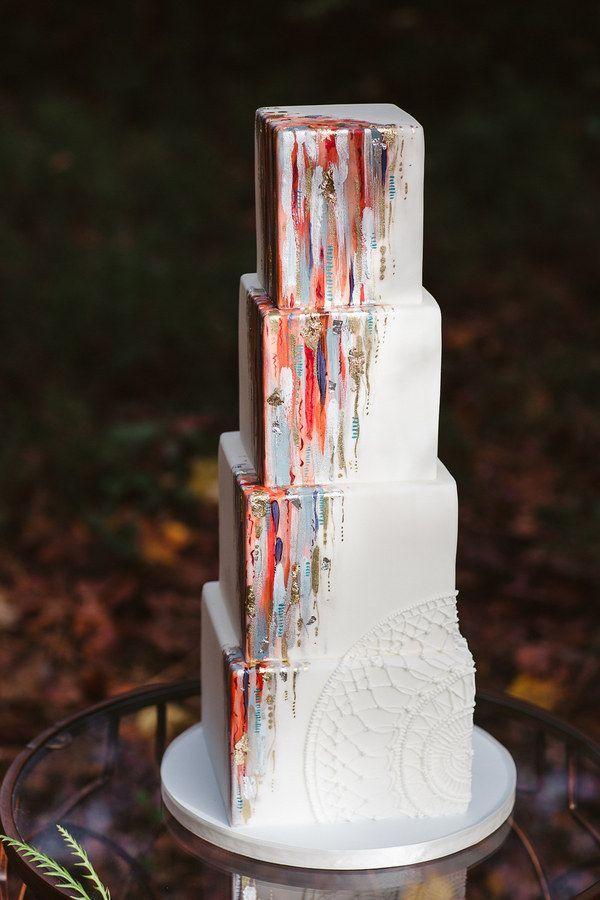 This elegant brushstroke and white piping combo. | 27 Strikingly Beautiful Wedding Cake Details