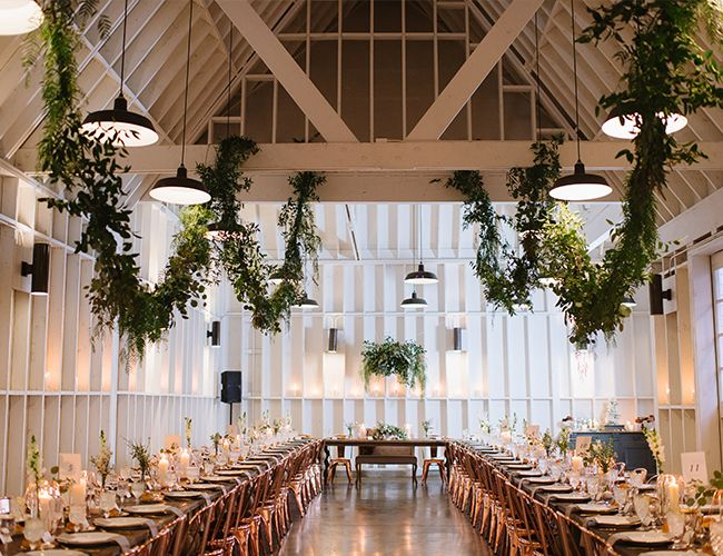 This blush and copper wedding at Lombardi House is fresh, modern, and intimate. The white barn where they wed is already charming and elegant, but with sleek copper chairs and layers of garland everywhere you look, it becomes even more special.