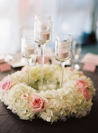 love this - simple and elegant. tall glass candleholders with bed of flowers. Just a little fuller then only doing to petals.