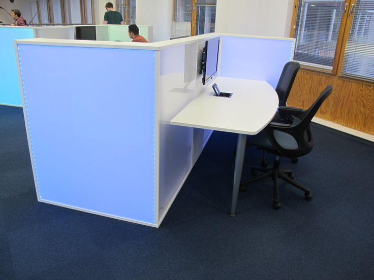 Collaborative desk with illuminated side panels for Nottingham Trent University Boots Library.  Designed by Opening the Book.