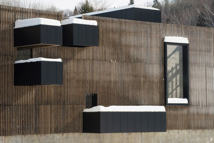 "Timber slats envelope this hydroelectric power plant by Atelier Pierre Thibault, which is stationed near a Quebec ""ghost town"""