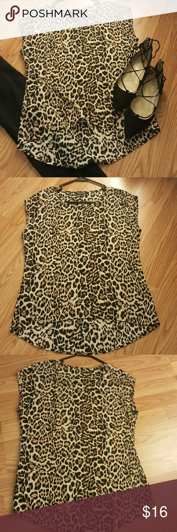 Cheetah print short sleeved shirt Small, cheetah print short sleeved shirt, perfect shirt to dress up for a night on the town or to dress down for a more casual look. HeartSoul Tops Blouses