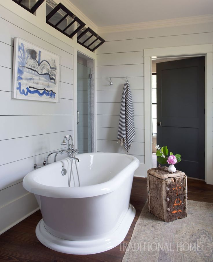Shiplap walls from the bedroom carry over into the master bath of this farmhouse. - Photo: Sarah Dorio / Design: Cloth & Kind