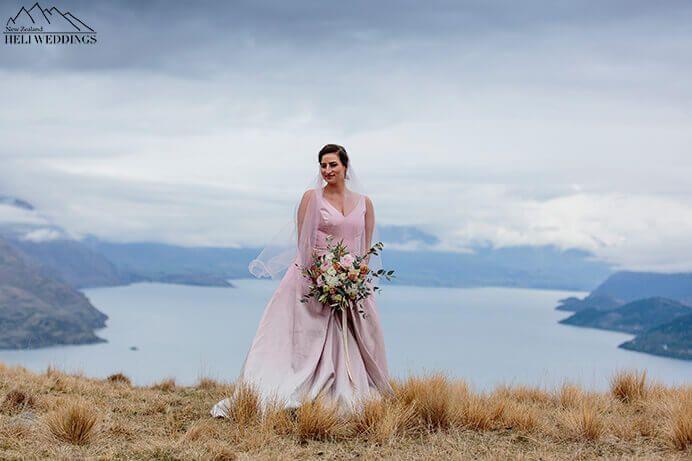 New Zealand destination wedding in Queenstown. Bride wears pink wedding gown
