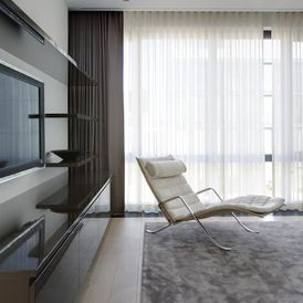 contemporary family room with ripple fold pleated curtains