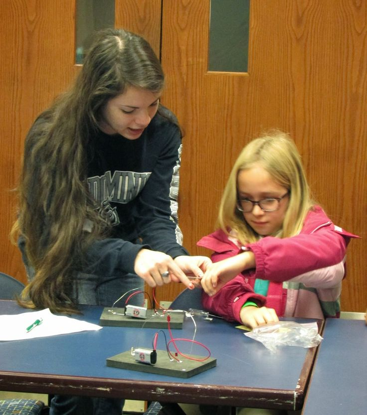Girl Scouts put together electrical circuits during Society of Women Engineers Day #STEM
