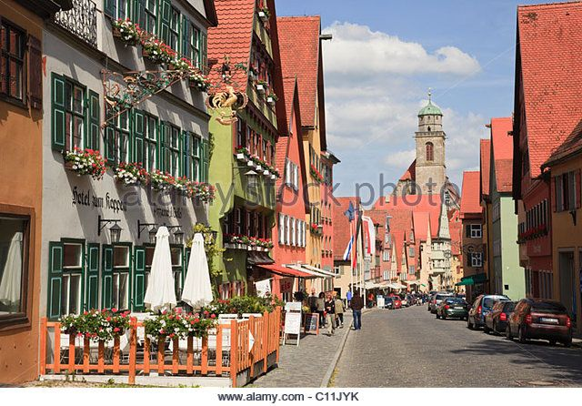 Dinkelsbühl, Bavaria, Germany. Street scene with hotel café in medieval old town on the Romantic Road - Stock Image