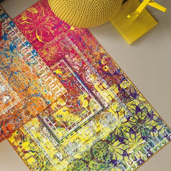 Antigua Rugs from the Arte Espina New Classics range features a traditional design with a modern twist in bright and bold yellow, pink and orange colour tones. #HomeDecor #Rugs