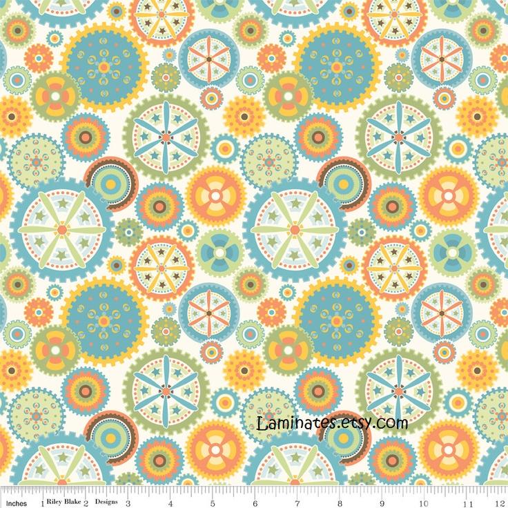LAMINATED fabric Gears on cream (aka oilcloth, coated, vinyl) Mod Tod yardage yard. $12.95, via Etsy.