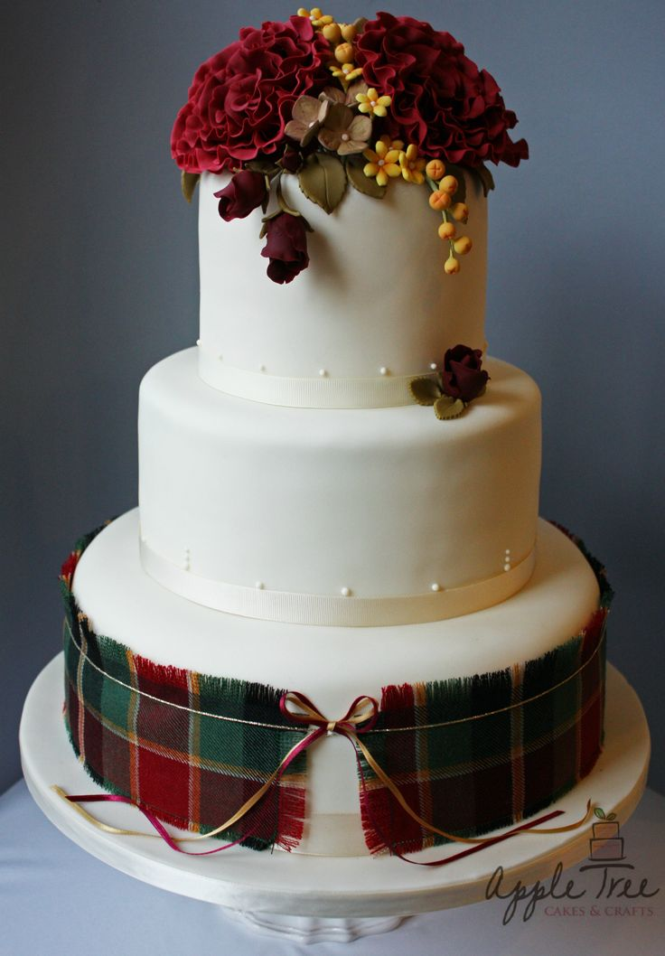 Scottish autumnal wedding cake with the groom's family tartan and handmade sugar flowers in colours to match. Apple Tree Cakes & Crafts Ltd http://www.appletreecakesandcrafts.co.uk