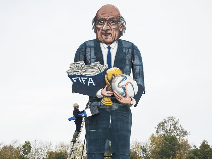 British artist Frank Shepherd of the Edenbridge Bonfire Society puts the finishing touches to a giant effigy of the suspended president of FIFA Sepp Blatter in Edenbridge, Kent, southeast England that will be exploded and burned at this year's Bonfire Night celebrations. The Edenbridge Bonfire Society has been making fun of public figures for 20 years by building and exploding a second 'celebrity Guy' effigy alongside their traditional figure of Guy Fawkes as part of the Bonfire Night…