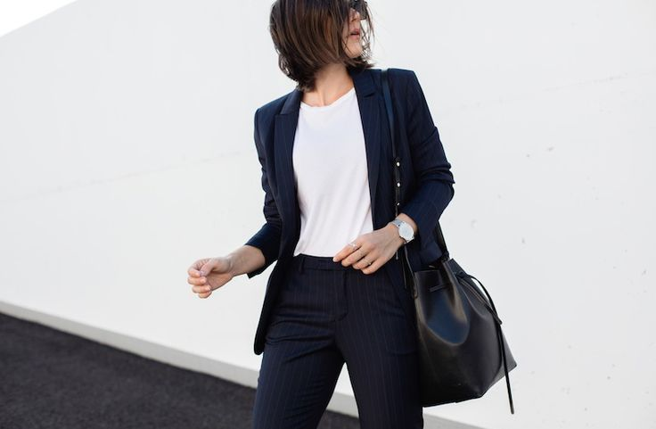 "Carola Pojer, takes on the age old (and trend-alert!) pinstriped suit to show us how to ""Girl Boss"" our way to a modern tailored look"