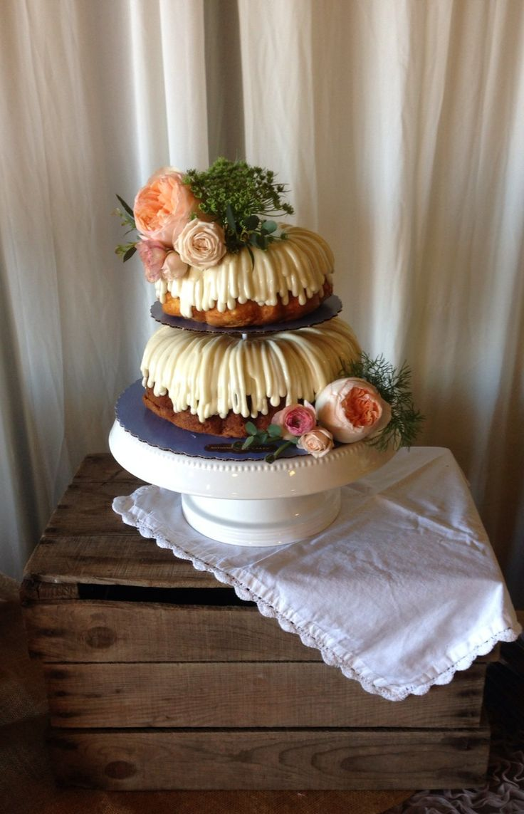 Nothing Bundt Cakes (Tualatin location) tiered cake with drizzle frosting and real floral- arranged by Bella Floral of Portland, OR. Photo taken at Langdon Farms