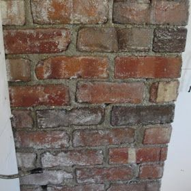 Exposing, cleaning, and sealing a brick chimney