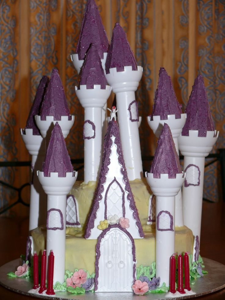 The Castle cake from hell - uses a kit to add the turrets etc but it was horribly difficult to keep the turrets from falling over. And icing plastic is not as easy as I thought! The cake itself was white chocolate mud cake with white chocolate ganache icing.