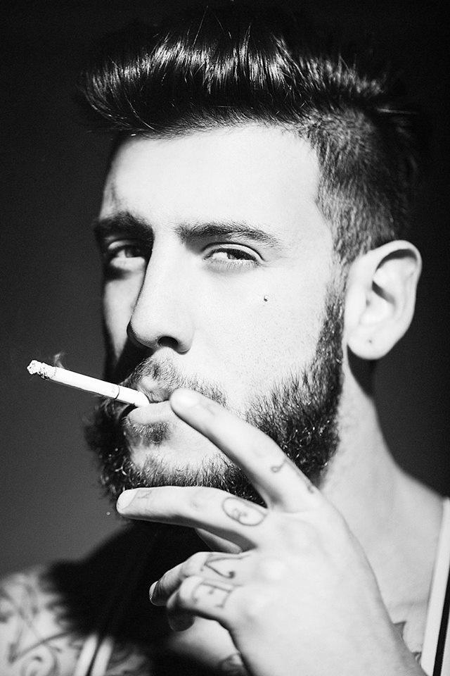 Tattooed boy with a cigarrette