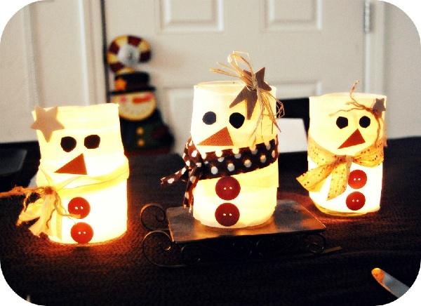 mason jar snowmen lanterns. Might be cute with baby food jars.