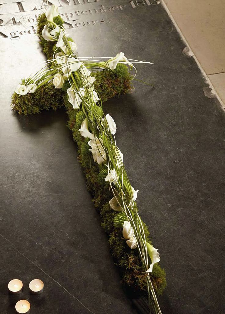Cross tributes can be laid on the coffin or standing on the headstones.