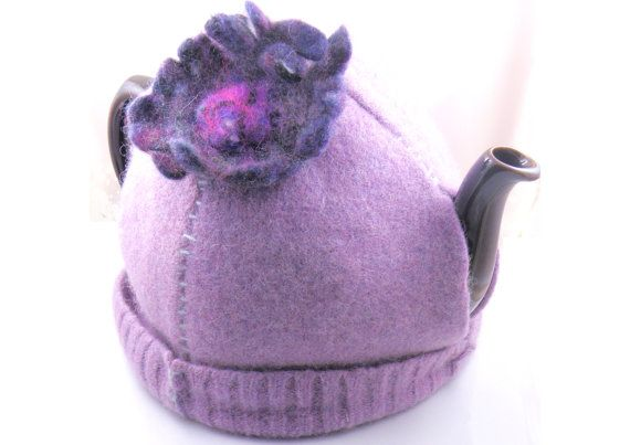 Tea cozy at https://www.etsy.com/ca/shop/ElizabethLovesGlass. Upcycled felt from a vintage sweater. Made by Elizabeth Wellburn in Victoria, BC Canada. Order in November and use the coupon code FRIDAY2014 for 20% discount.